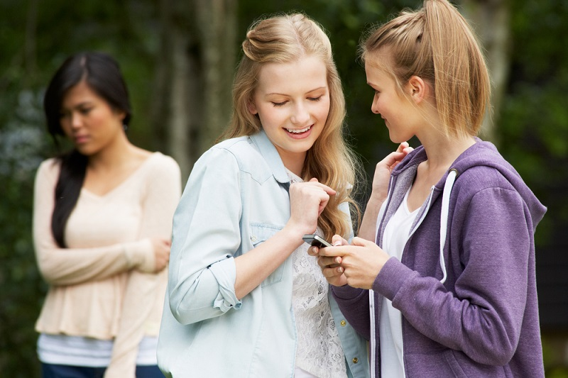 teenage-girl-being-bullied-by-text-message-on-mobile-phone